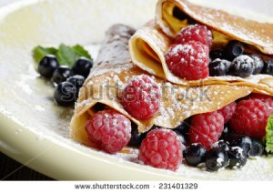 stock-photo-delicious-tasty-homemade-crepes-with-raspberries-231401329